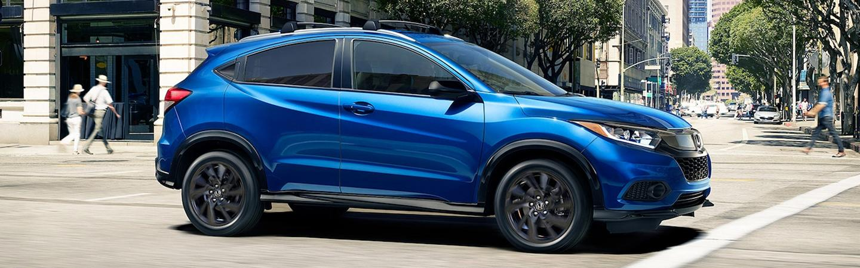 Side profile of a parked blue Honda HR-V