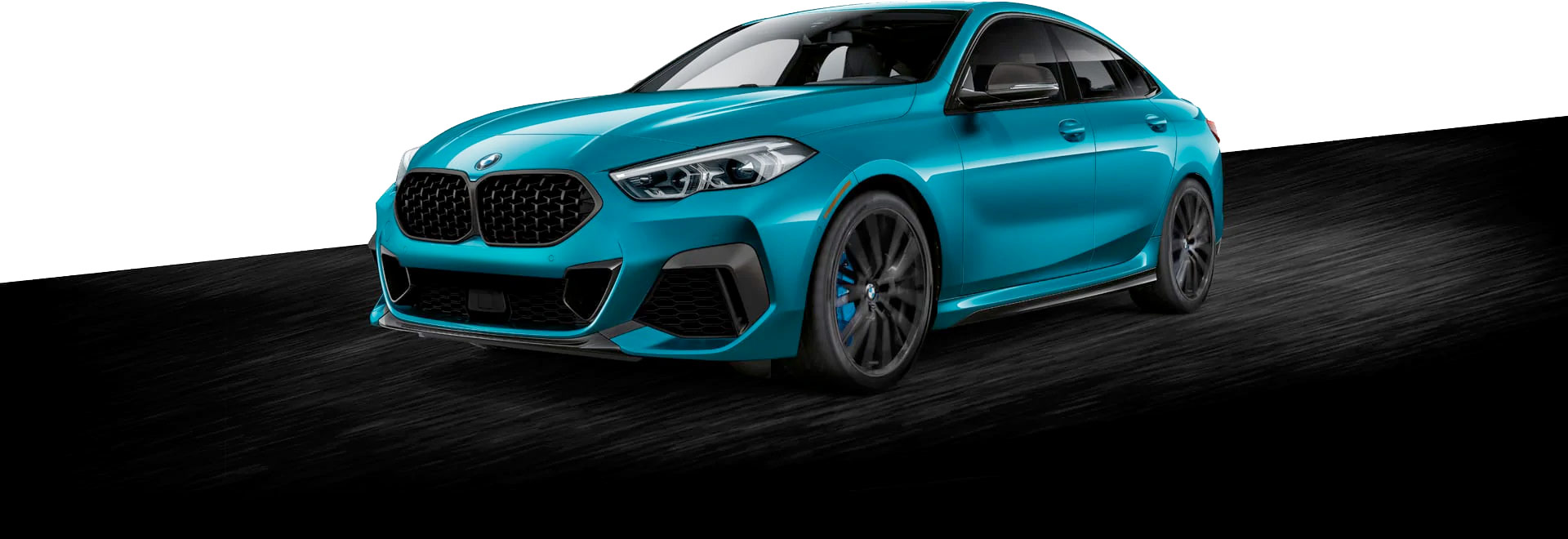 Blue 2020 BMW 2 Series Gran Coupe driving on road