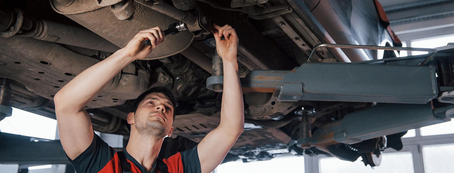 Service tech working on a Kia.