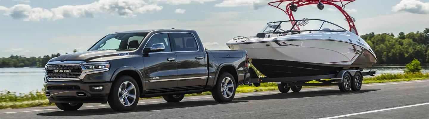 2021 RAM 1500 towing a boat in Madera, CA