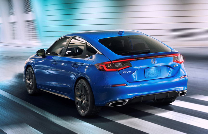 Rear view of a blue Honda Civic in motion