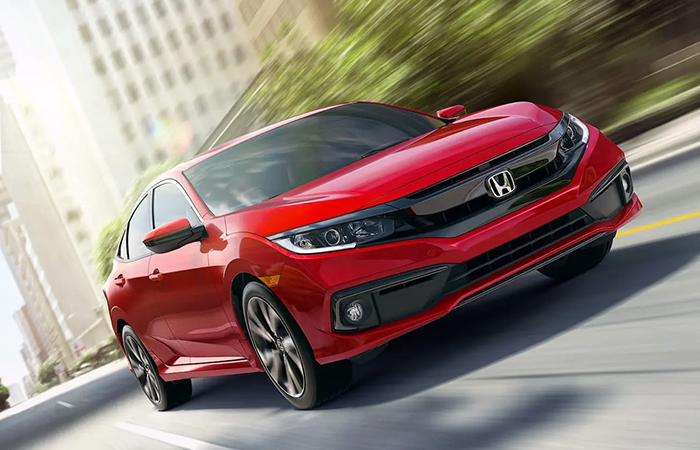 Front view of a red Honda Civic in motion