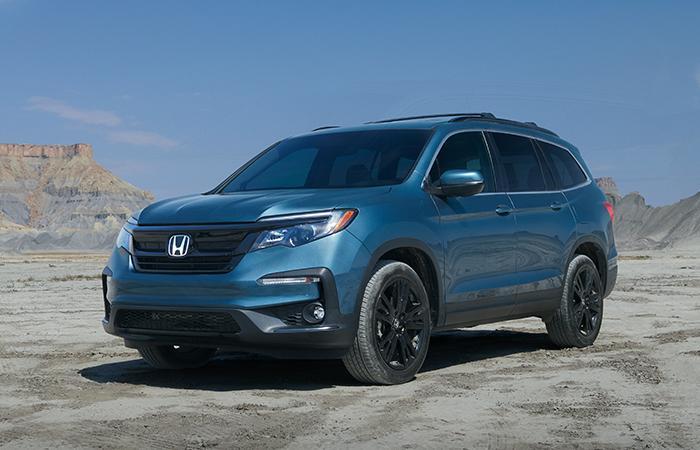 Angled profile of a parked blue Honda Pilot