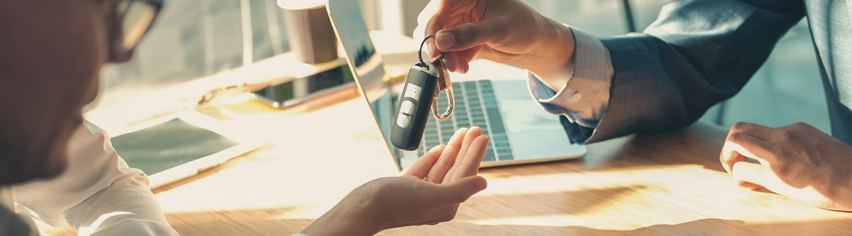 salesperson handing keys to buyer