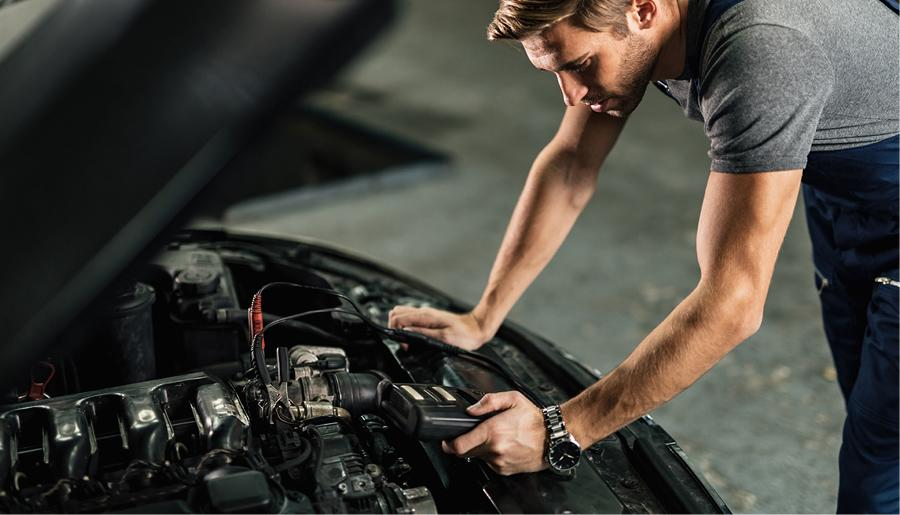 Service Tech working on an engine at Kia in Cleveland