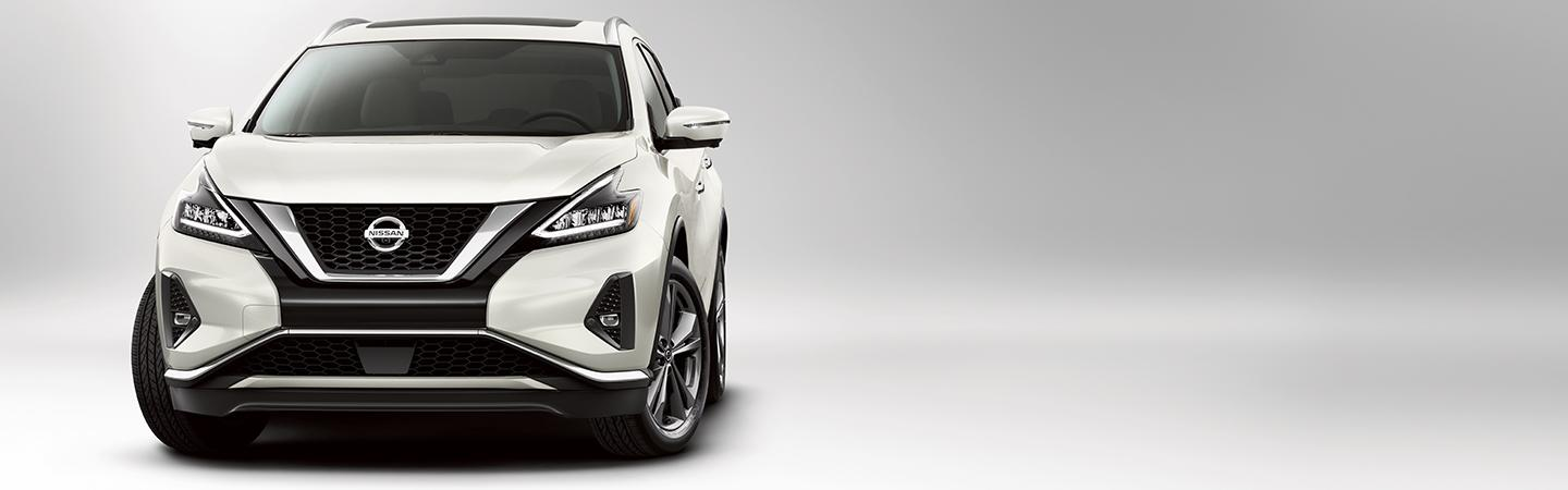 Front view of a parked white Nissan Murano