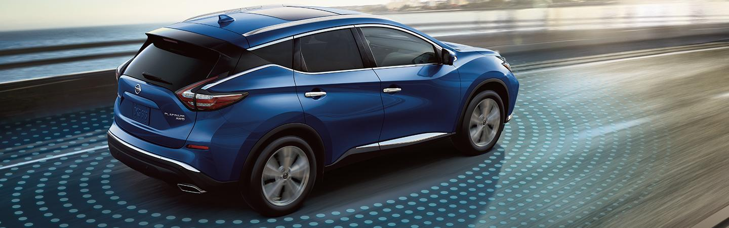 Side profile of a blue Nissan Murano in motion