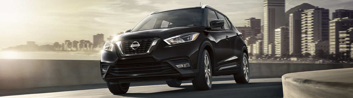 Front view of a black 2020 Nissan Kicks in motion