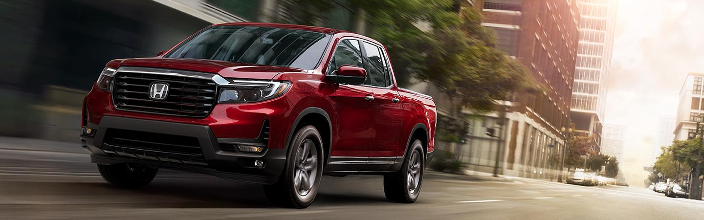 2021 red Ridgeline driving downtown
