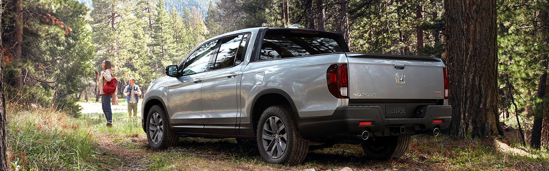 Silver 2021 Nissan Ridgeline in the woods