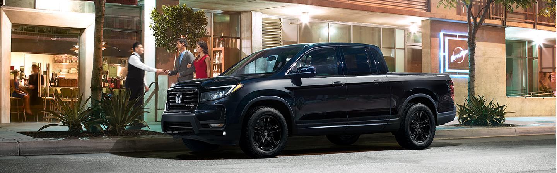 Couple valet parking their black 2021 Nissan Ridgeline
