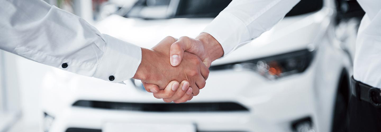 A handshake confirming new car deal