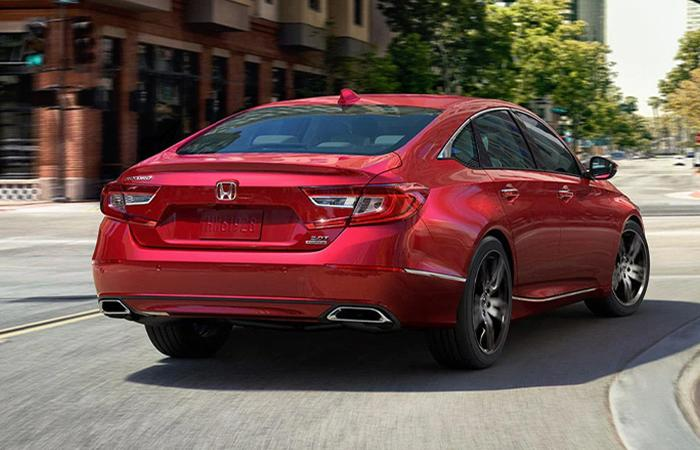 Rear view of a red Honda Accord in motion