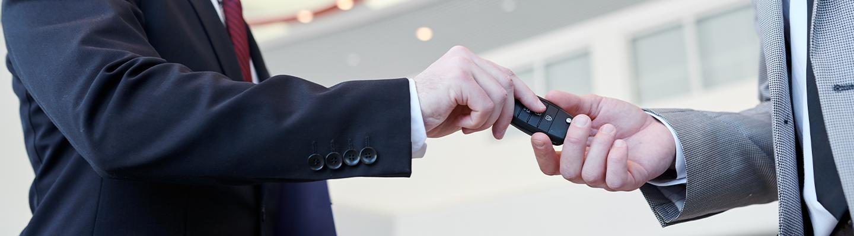 Keys exchanging hands
