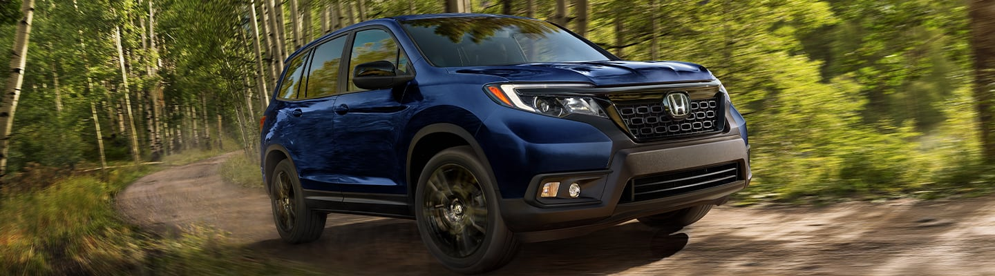 Front view of a 2020 Honda Passport Sport in motion outdoors