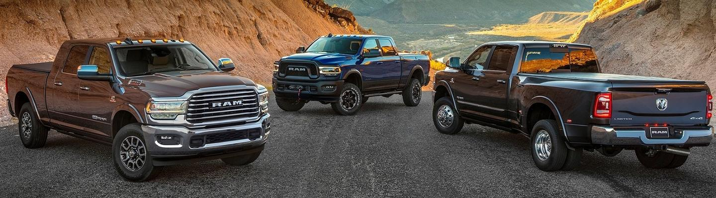 A line up of Ram heavy-duty trucks.