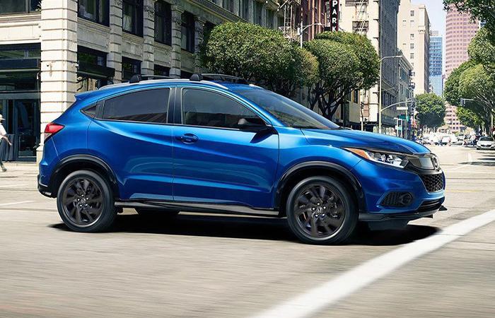 Side profile of a blue Honda HR-V in motion