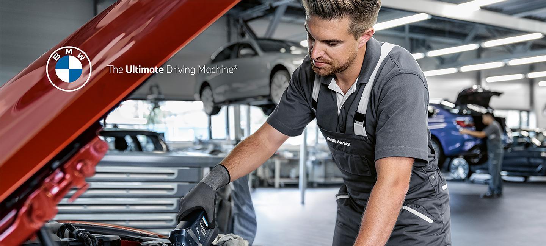 BMW service tech changing oil