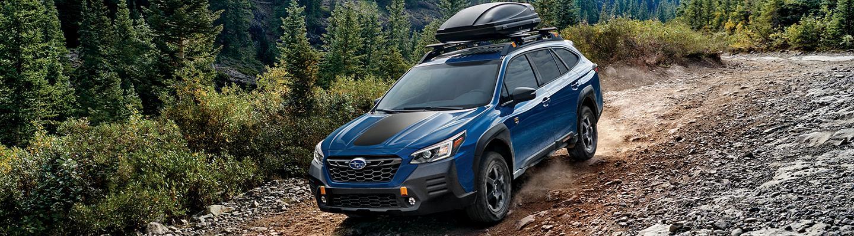 Blue 2022 Subaru Outback on Mountain Trail