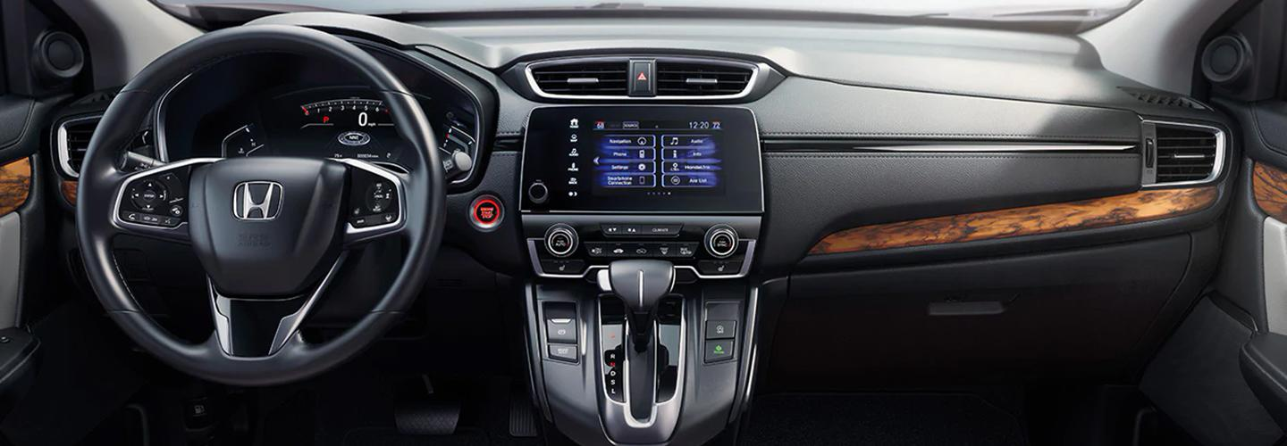Driver's side view of a Honda CR-V's interior and dashboard