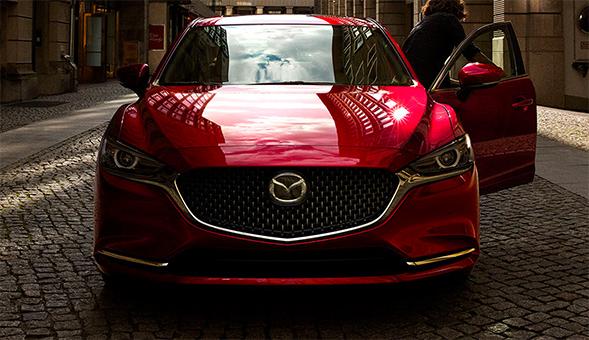 front of Mazda vehicle