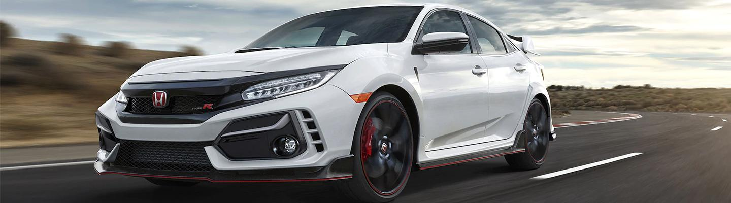 Angled profile of a white Honda Civic Type R in motion