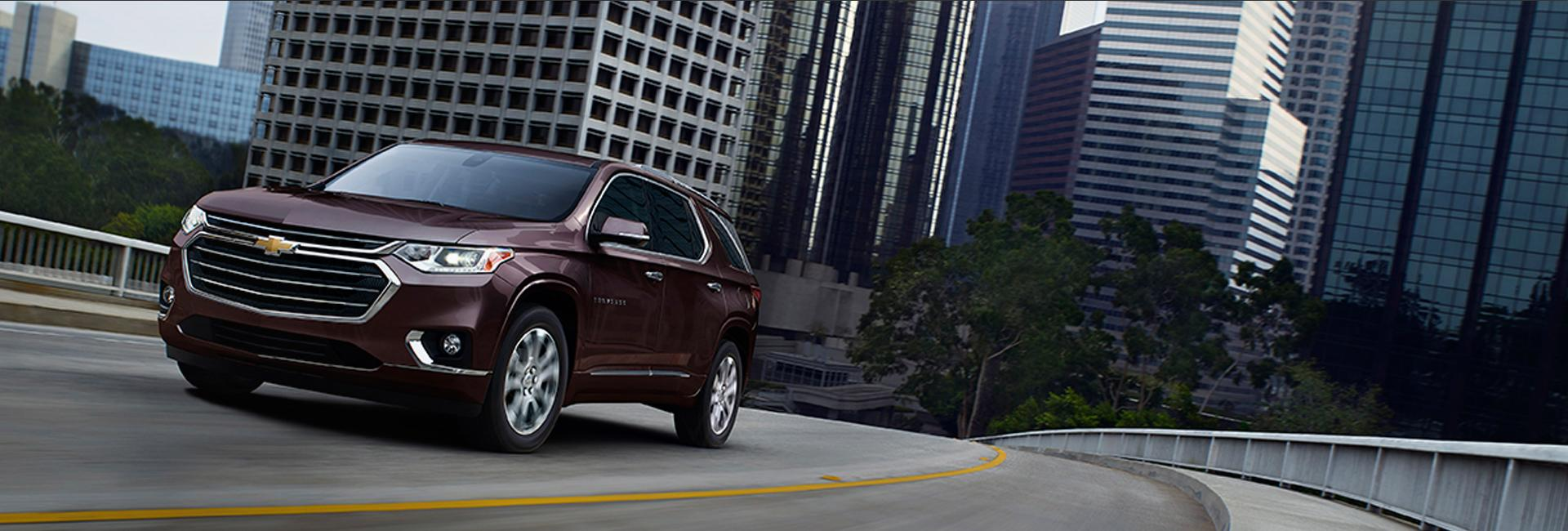 Angled profile of a Chevy Traverse in motion