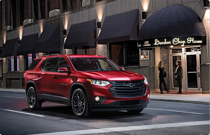 Angled profile of a red Chevy Traverse