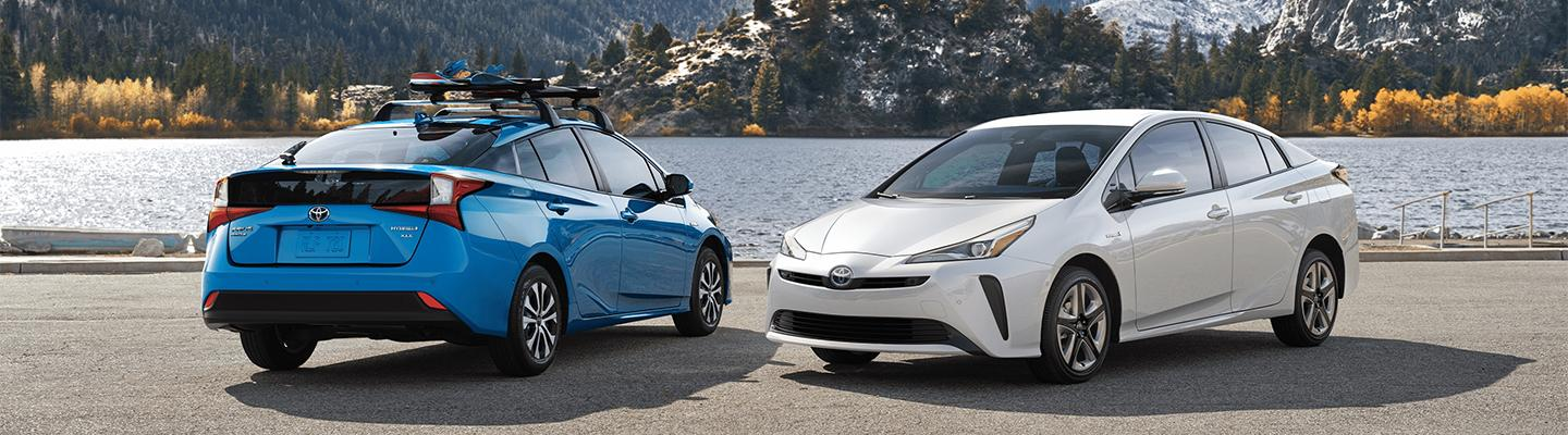 Two 2020 Toyota Prius vehicles parked
