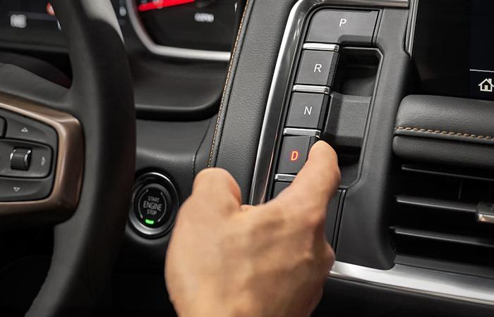 Close up view of a Chevy Suburban push-button gears