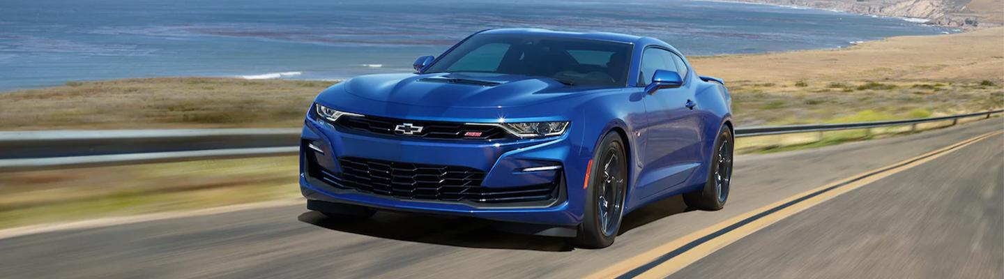Angled profile of a blue Chevy Camaro in motion