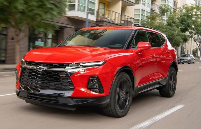 Angled profile of a red Chevrolet Blazer in motion