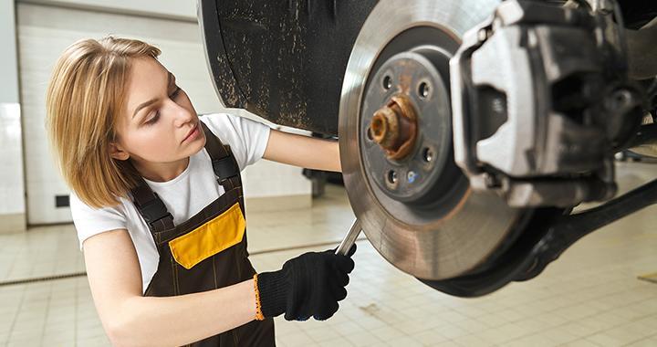 Woman technician working on a car