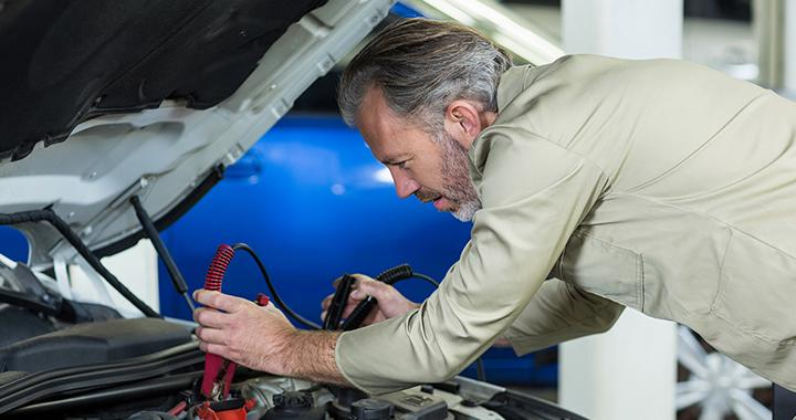 A man working on a Nissan car