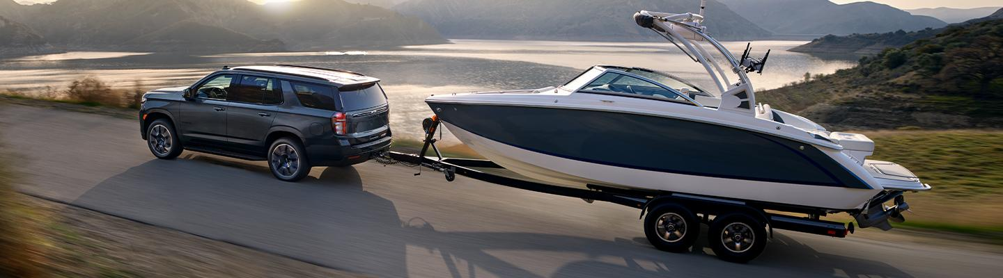 2021 Chevy Tahoe towing a boat in motion
