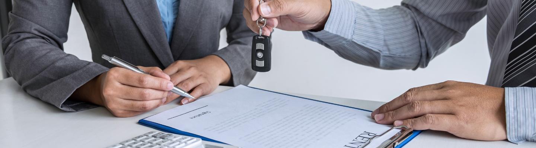 A new Hyundai driver sign paperwork at the dealership