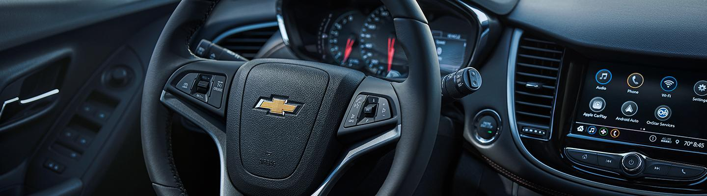 Detailed view of the 2021 Chevy Trax steering wheel and dash