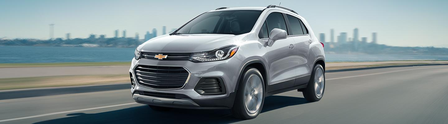 Sliver 2021 Chevy Trax in motion near the ocean