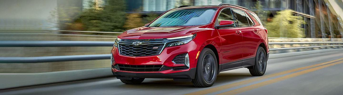Red 2021 Chevy Equinox on city street