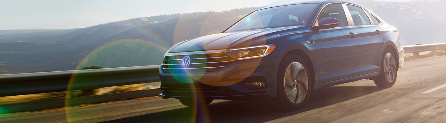 Front view of the grille of the 2020 Volkswagen Jetta in motion