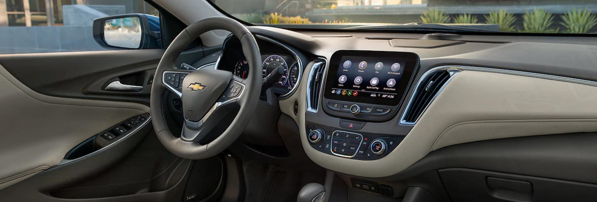 Close up view of a Chevy Malibu steering wheel and dashboard