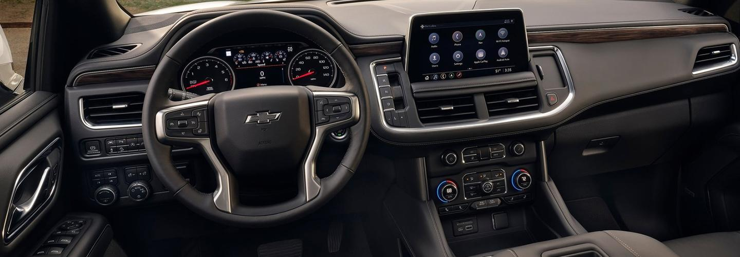Close up view of a Chevy Tahoe's steering wheel and dashboard