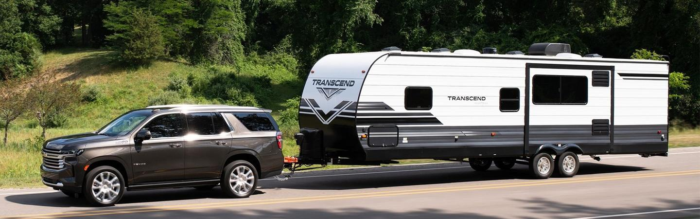Angled profile of a black Chevy Tahoe towing a trailer