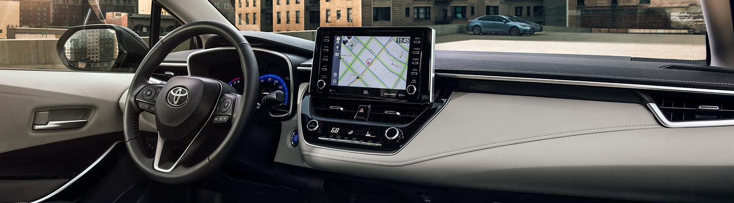 2021 Toyota Corolla's interior front dash and steering wheel view