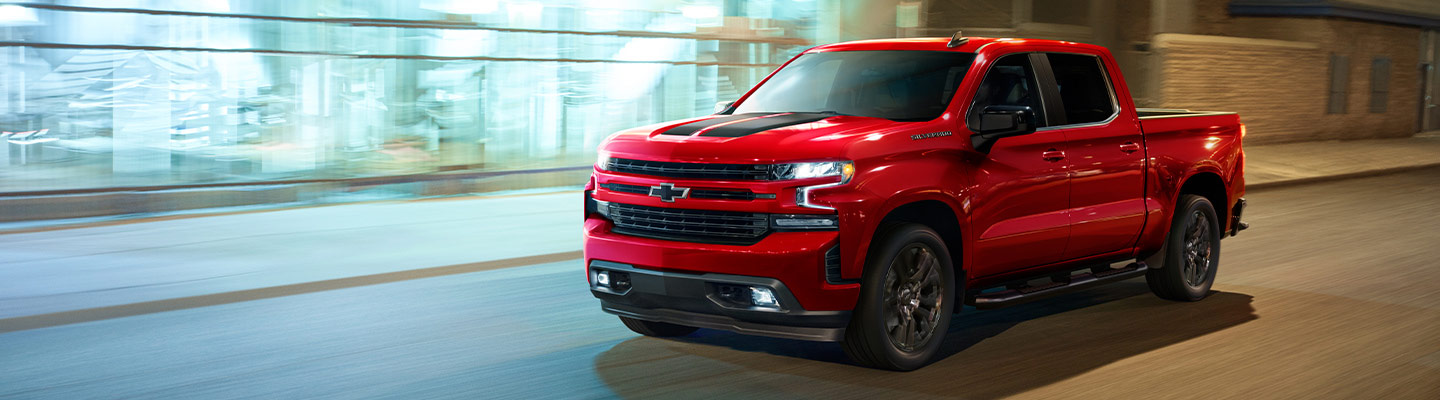 Red 2021 Chevy Silverado in motion.