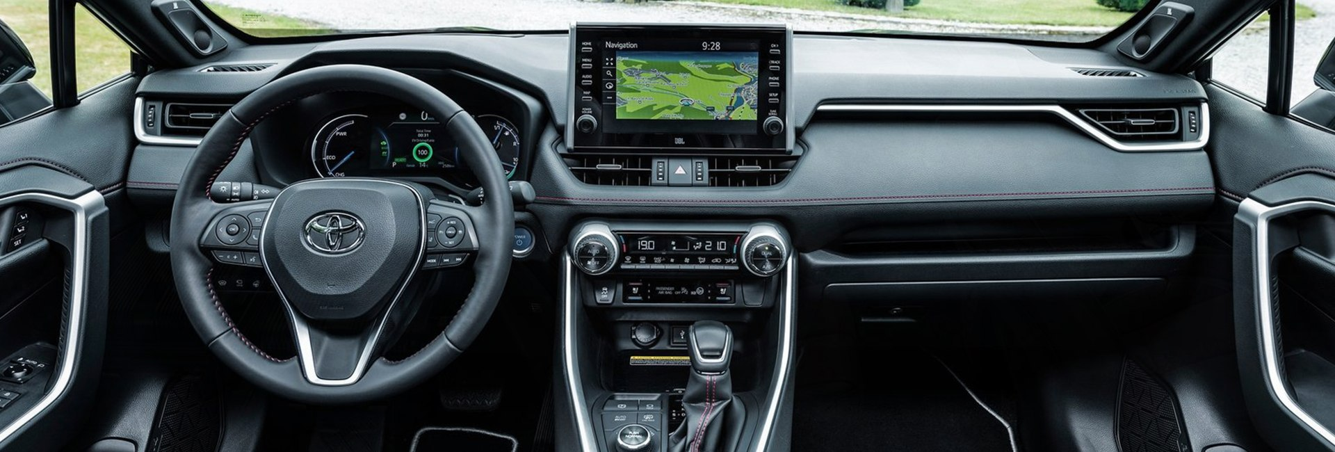 Close up view of a Toyota RAV4 Hybrid's steering wheel and dashboard