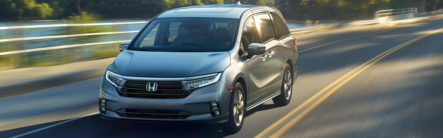 Front view of a 2021 Honda Odyssey in motion