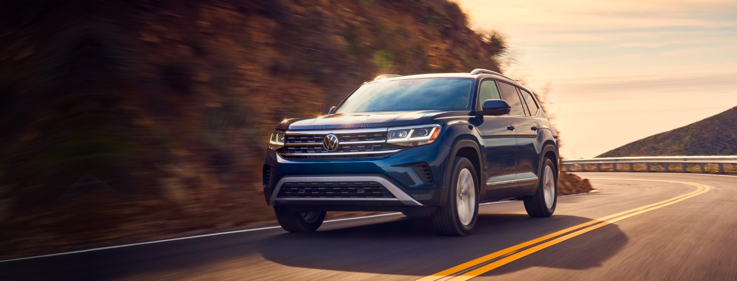Front view of a 2021 Volkswagen Atlas in motion