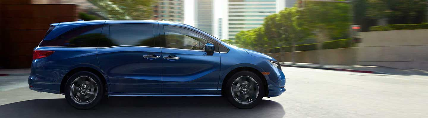 Full side profile view of a blue 2022 Honda Odyssey