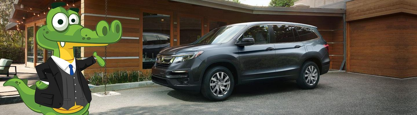 Side view of a 2021 Honda Pilot parked in a driveway